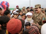 COAS General Raheel Sharif on the Eid day visited IDP camp at Bannu and spent his time with children and IDPs.  PHOTO: ISPR