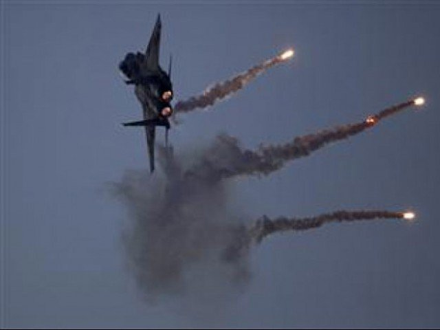 ISPR says two arms and ammunition dumps also destroyed in the strikes. PHOTO: AFP