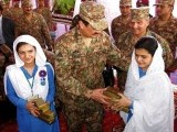 Army Chief Gen Raheel Sharif hands out gifts among school girls at the IDP camp in Bannu on Saturday. PHOTO: ONLINE