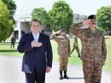 Prime Minister Nawaz Sharif (L) stands next to COAS Gen Raheel Sharif (R) at the GHQ on Thursday. PHOTO: APP