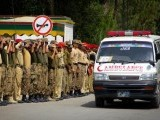 An ambulance drives away the body of a soldier who was killed by in an IED explosion on Friday. PHOTO: ASIM BAJWA ISPR