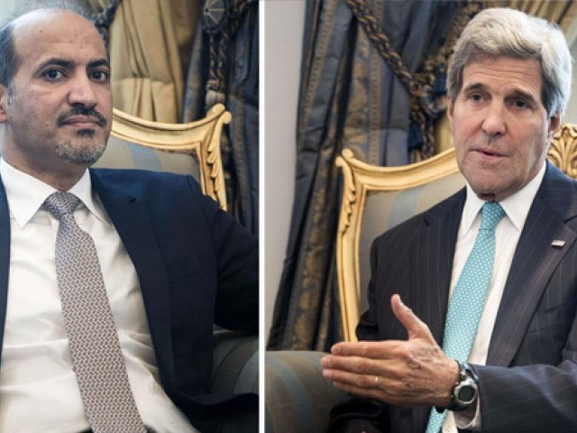 U.S. Secretary of State John Kerry (R) and Ahmad Jarba (L), leader of Syrian National Coalition, wait prior to a meeting at King Abdulaziz International Airport in Jeddah. PHOTO: REUTERS