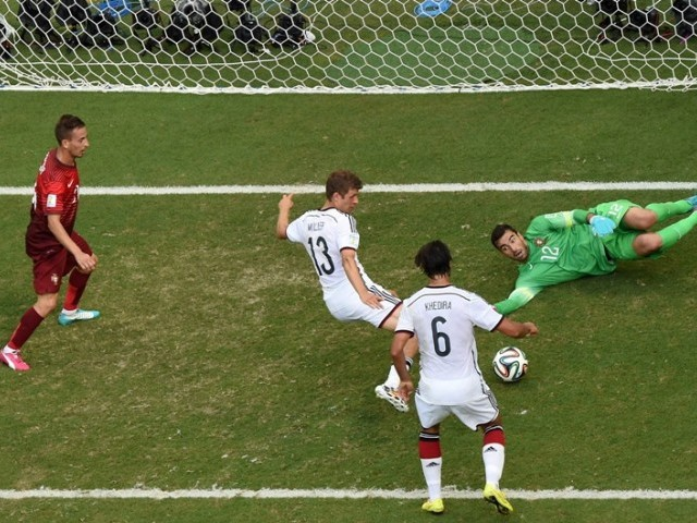 Germany's forward Thomas Mueller (C) is watched by Germany's midfielder Sami Khedira (2R) as he scores his third goal past Portugal's goalkeeper Rui Patricio (R) during the Group G football match between Germany and Portugal at the Fonte Nova Arena in Salvador on June 16, 2014, during the 2014 FIFA World Cup. PHOTO: AFP