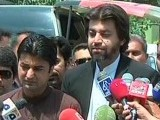 Express News screengrab of PTI MNAs Murad Saeed (L) and Ali Muhammad Khan (R) speaking to the media outside the ECP.