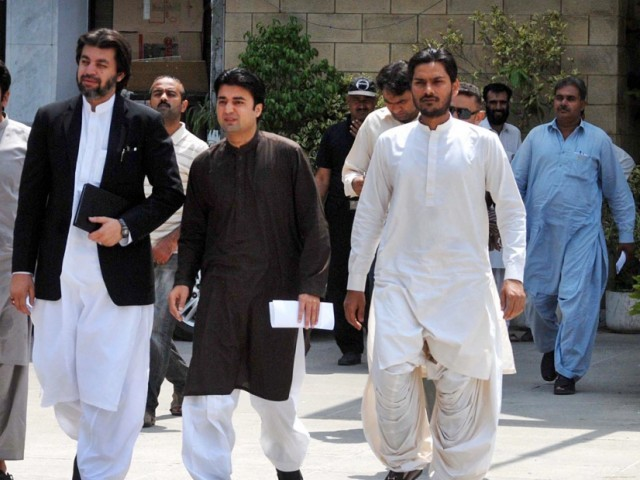 PTI MNAs Muraas Saeed and Ali Muhammad Khan seen coming out of the Election Commission of Pakistan after filing a petition against Prime Minister Muhammad Nawaz Sharif. PHOTO: ONLINE