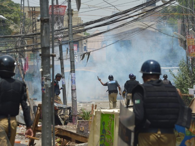 File photo of the Model Town clashes. PHOTO: MEHMOOD QURESHI/EXPRESS