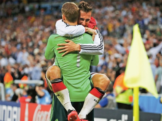 Germany's Miroslav Klose hugs teammate Manuel Neuer after Mario Goetze scored against Argentina during extra time. PHOTO:REUTERS