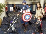 "Family, Assemble! Eric Royster (L) in costume as ""Captain America"" walks with his wife Andrea O'Leary and 4-year-old daughter Isabella as they enjoy the pop culture convention Comic Con in New Orleans, Louisiana January 28, 2012. PHOTO: REUTERS"