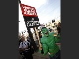 """Hulk, smash!""  A striker dressed as the Incredible Hulk gestures on the picket line with the Writers Guild of America at the NBC television network studios in Burbank, California November 16, 2007. PHOTO: REUTERS"