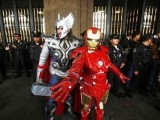 Artists dressed as Thor and Iron Man pose for photographers next to a line of police officers during a demonstration outside the Federal District Government building at Zocalo Square in Mexico city July 13, 2012. The artists were requesting that the police would allow them to conduct their street performances, public dialogues and various art work in public places. PHOTO: REUTERS