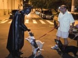 Retired Brazilian police officer Andre Luiz Pinheiro, 50, dressed as super-hero Batman, is greeted by a dog on March 26, 2012. Pinheiro was called to help police patrol the crime-ridden streets of Taubate, in Brazil. Police captain Warley Takeo, one of the policemen who decided to bring in the character to help them fight drug traffickers, said making a connection between the police and Batman would help children have a clearer idea of good and bad. PHOTO: REUTERS