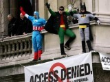 Police officers stand nearby as Fathers 4 Justice protestors dressed as Batman, Robin and Captain America wave whilst standing above Downing Street in London February 28, 2005. PHOTO: REUTERS