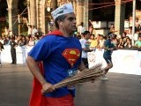 This looks like a job for Superman! A runner and Aam Aadmi Party (AAP)'s supporter wearing a Superman costume and sporting the party's trademark cap and symbol - the broom - takes part in the Mumbai Marathon on January 19, 2014. PHOTO: AFP
