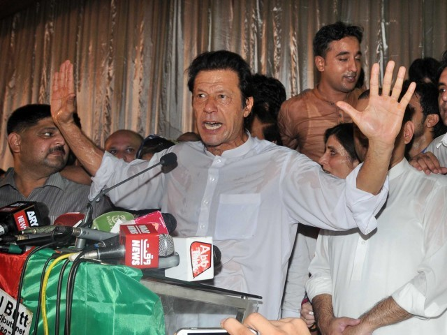 PTI chairman Imran Khan addressing worker's convention in Lahore. PHOTO: EXPRESS/WASEEM NIAZ