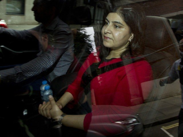 Britain's former senior minister of state at the Foreign and Commonwealth Office and minister for faith and communities, Baroness Warsi, is driven away from her home in central London on August 5, 2014, after she resigned over the government's position on the conflict in Gaza. PHOTO: AFP