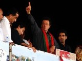 Imran Khan gestures towards the crowd on Saturday evening. PHOTO: ONLINE