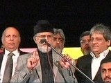 PAT chief Dr Tahirul Qadri (C) on stage with Punjab Governor Chaudhry Sarwar (L) and Sindh Governor Dr Eshratul Ibad Khan. PHOTO: EXPRESS NEWS SCREENGRAB
