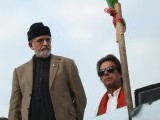 PTI chairman Imran Khan and PAT chief Dr Tahirul Qadri on the same platform. PHOTO: AFP