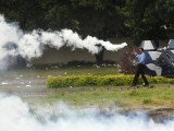 A policeman fires tear gas to disperse supporters of Tahirul Qadri as they move towards the prime minister's house in Islamabad September 1, 2014. PHOTO: AFP
