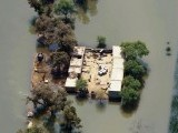 This photograph taken from an army helicopter shows an aerial view of residents at their houses surrounded by floodwaters in the flooded area of Peer Kot in Jhang on September 11, 2014. PHOTO: AFP