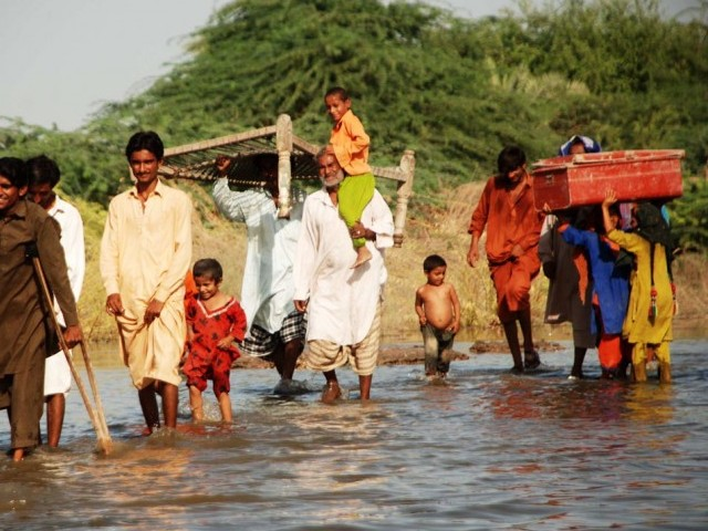 Residents of Bagarjee flee as the waters rise. PHOTO: ONLINE