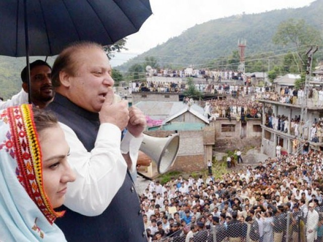 Prime Minister Nawaz Sharif talking to residents in Forward Kahuta, Azad Kashmir. PHOTO: PID