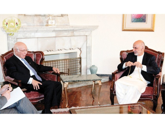 PM's adviser Sartaj Aziz talks with Afghan President Ashraf Ghani. PHOTO: NNI
