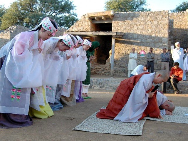 Korean Buddhists participate in Prayer Ceremony for Peace and Stability at Jaulian, ruins of an ancient Buddhist monastery in Haripur, K-P.  PHOTO: INP