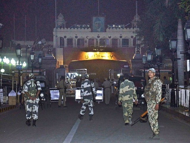 Members of the Indian Border Security Force (BSF) stand guard at the Wagah India-Pakistan International Border on November 2, 2014, following a suicide bomb attack on the Pakistani side of the Wagah border gate. PHOTO: AFP