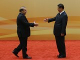 China's President Xi Jinping (R) shakes hands with Pakistan's Prime Minister Nawaz Sharif at their family photo session prior to the Dialogue On Strengthening Connectivity Partnership at the Diaoyutai State Guesthouse in Beijing on November 8, 2014.  The Pakistani leader is here on the sidelines of the Asia-Pacific Economic Cooperation (APEC) Summit in the Chinese capital. PHOTO: AFP