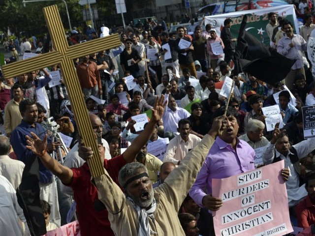 Protesters chant slogans against the murder of a Christian couple during a protest in Lahore on November 9, 2014. PHOTO: AFP