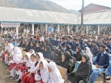 Students of Shahpur school and village people listen to the telephonic address of Malala Yousafzai. PHOTO: UMAR BACHA / EXPRESS