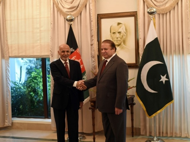Afghan President Ashraf Ghani (L) and Pakistani Prime Minister Nawaz Sharif shake hands at the Prime Minister House in Islamabad on November 15, 2014. PHOTO: AFP