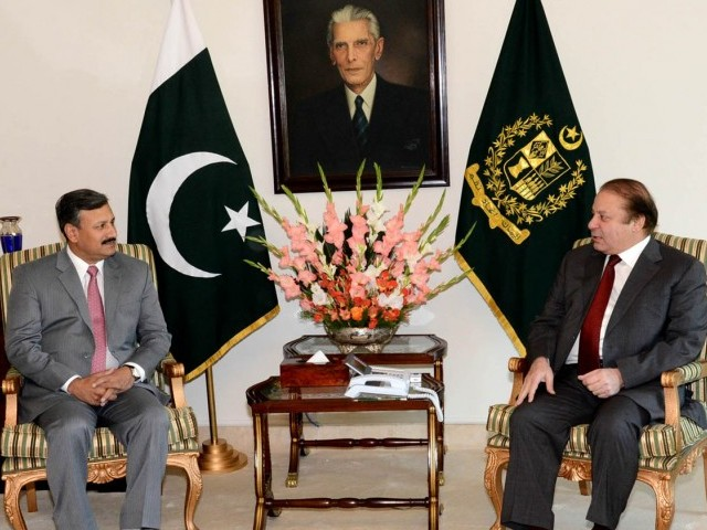 Prime Minister Nawaz Sharif talks to DG ISI Lt Gen Rizwan Akhtar. PHOTO: PID