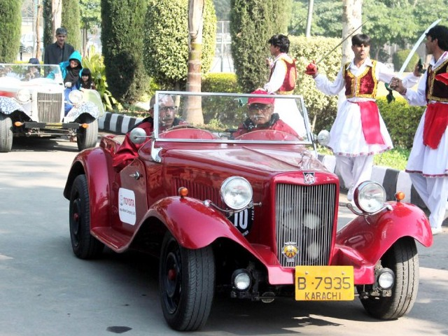Participants driving an MG Roadster at the Vintage Car rally. Members of the Vintage Car Club of Pakistan drove from Karachi to Peshawar for the rally. PHOTO: MUHAMMAD IQBAL / EXPRESS TRIBUNE