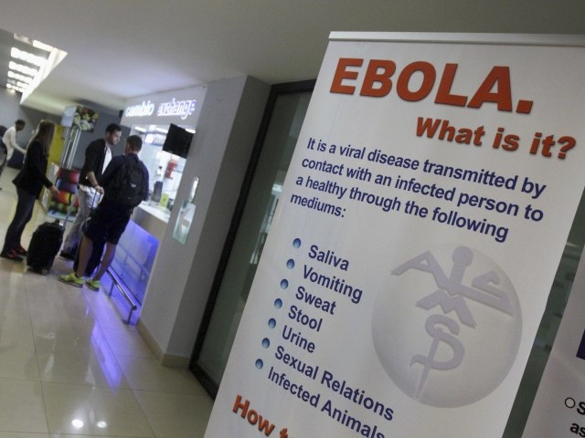 An sign explaining the symptoms of Ebola stands inside a hall for arriving passengers at the international airport in Guatemala City. PHOTO: REUTERS