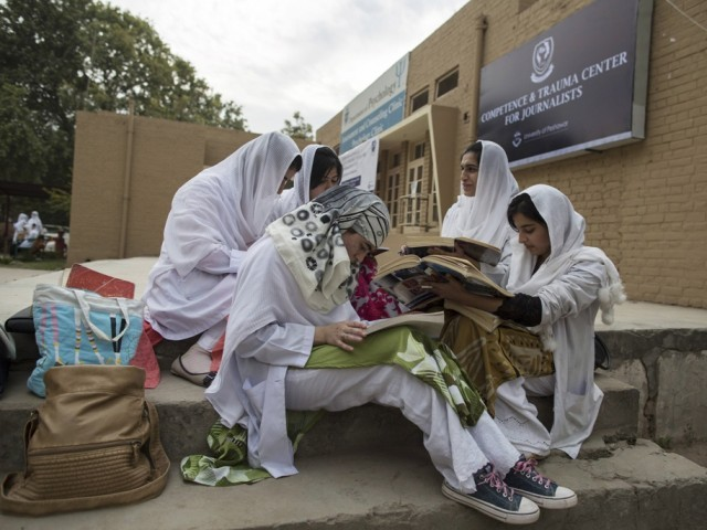 Psychology students study outside the Competence and Trauma Centre for Journalists inside a university's psychology department in Peshawar November 24, 2014. PHOTO: AFP
