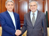 Finance Minister Ishaq Dar shaking hand with Iran's Minister for Economic Affairs and Finance Dr Ali Taieb Nia on Monday. PHOTO: PPI
