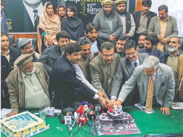 Secretary Sports and Youth Affairs Akbar Durrani cuts a cake to celebrate legendary actor Dilip Kumar's birthday at the Peshawar Press Club. PHOTO: INP