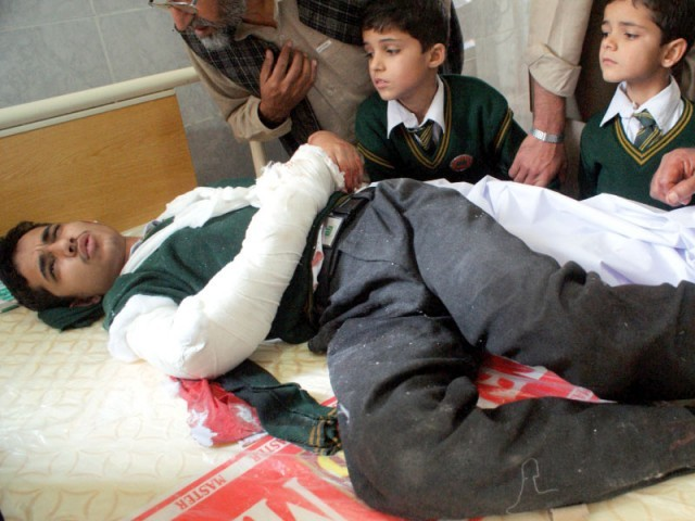 132 pupils, 9 staffers killed in Taliban attack on army school in Peshawar. PHOTO: AFP
