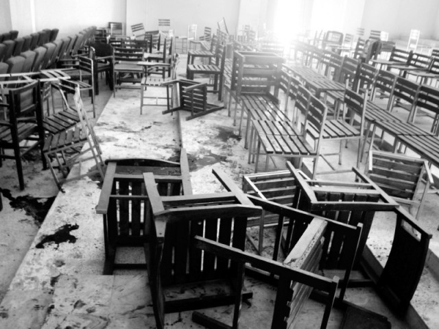 Overturned tables and chairs in a classroom at Army Public School. PHOTO: MUHAMMAD IQBAL/EXPRESS