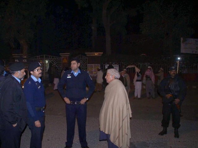 Police officials deployed outside Lal Masjid. PHOTO: INP