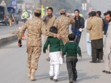 soldier-escorts-children-peshawar-school-attack-2