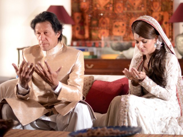 Imran Khan and his wife Reham Khan pray during their wedding ceremony. PHOTO: AFP