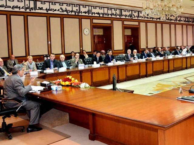 Finance Minister Ishaq Dar (L) addressing the donors conference at the PM House on Friday. PHOTO: PID