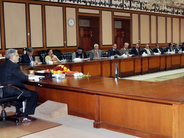 Finance Minister Ishaq Dar chairing the Governing Council of Pakistan meeting in Islamabad on Saturday. PHOTO: PID
