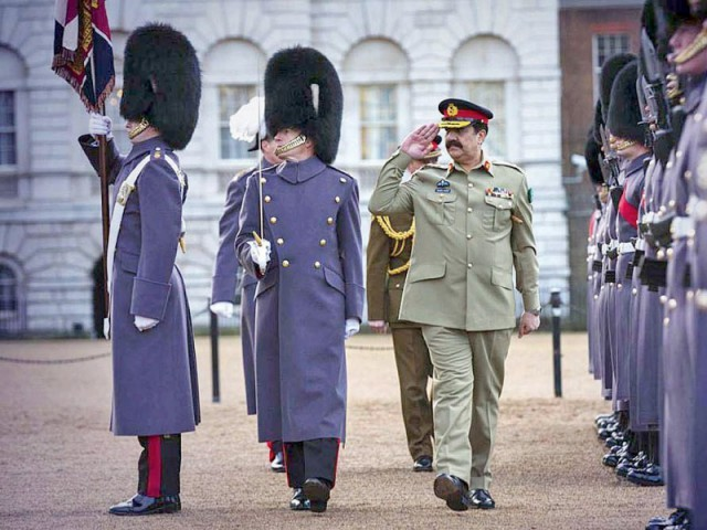 General Raheel Sharif reviews guard of honour in London. PHOTO: APP