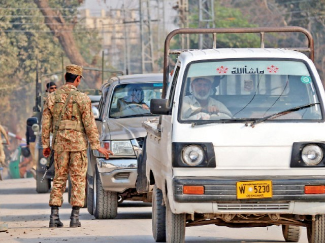 Security personnel deployed on Warsak Road. PHOTO: MUHAMMAD IQBAL/EXPRESS