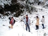Children play in the snow in Murree. PHOTO: ONLINE