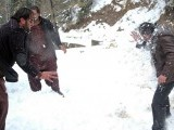 People play with snow at Nathiagali as the northern region recieved the season's first snowfall. PHOTO: ONLINE